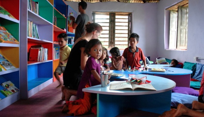 The first children try out the new library at Shree Prabhat in 2010. Today it can be difficult getting in the door, it's so popular!